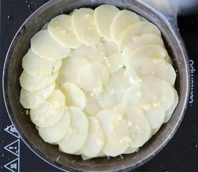 lastly finish with butter and garlic to make pommes anna