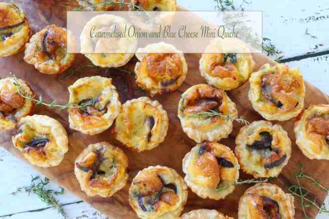 Caramelised Onion and Blue Cheese Mini Quiche on a timber board