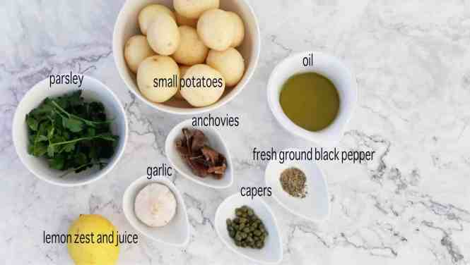 ingredients for Crispy smashed potatoes with roasted garlic and caper dressing