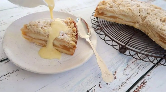 a slice of cake with Super Simple Creme Anglaise poured over the slice