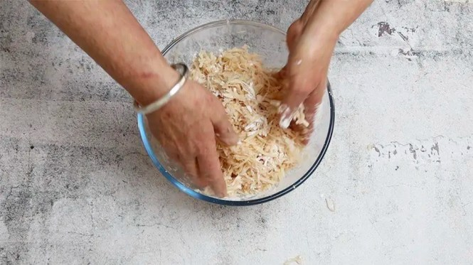 mixing in the cornflour to the potato mixture to make Crispy hash browns