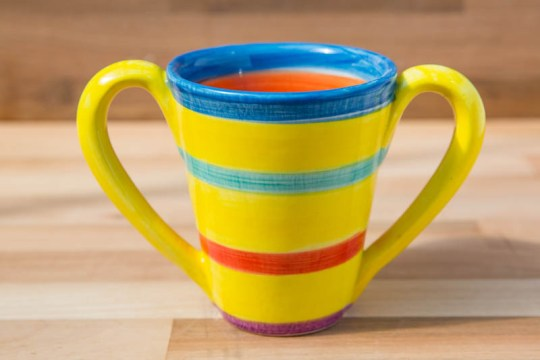 Tapered double handle mug in yellow