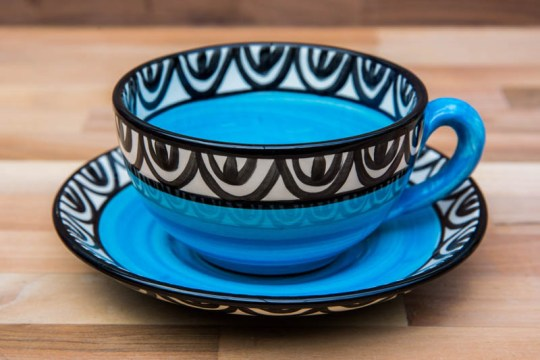 Aztec cup and saucer in bright blue