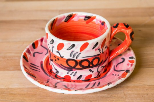 Abstract small cup and saucer in red