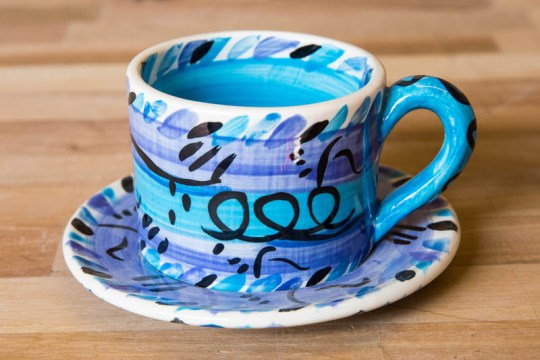 Abstract small cup and saucer in blue