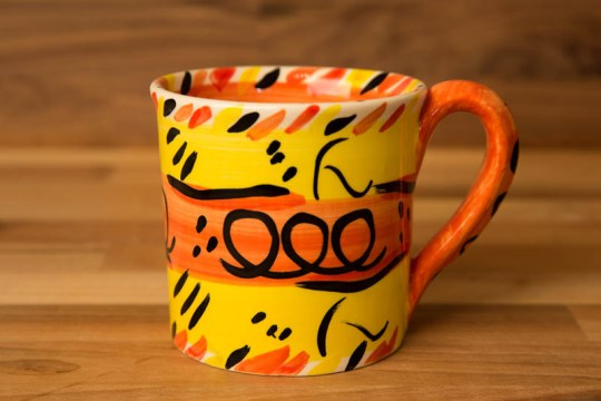 Abstract wide parallel mug in yellow