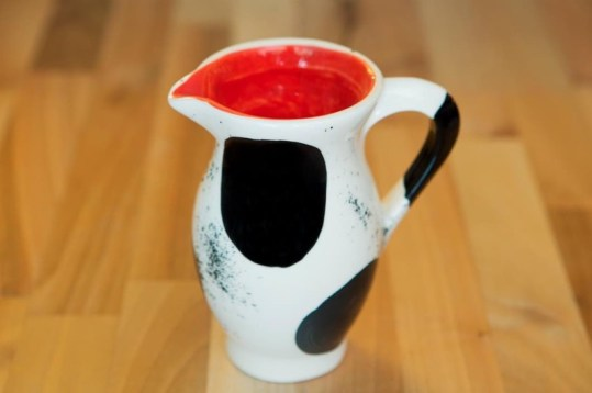 Black and white creamer jug in spot
