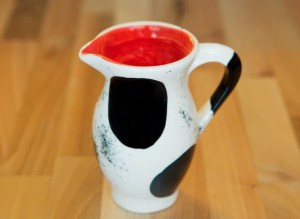 Black and white creamer jug in spot