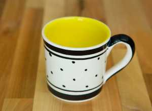 Black and white wide mug in polka dot