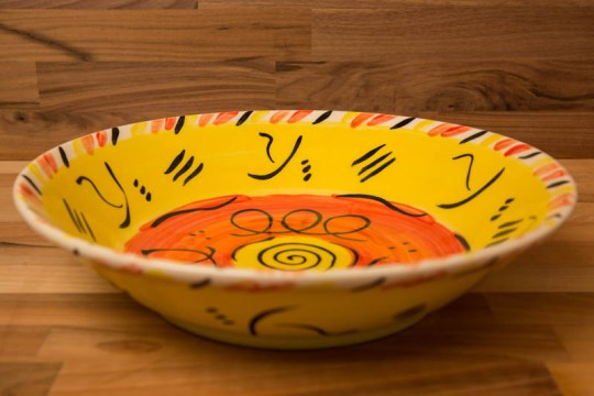 Abstract salad/fruit bowl in yellow