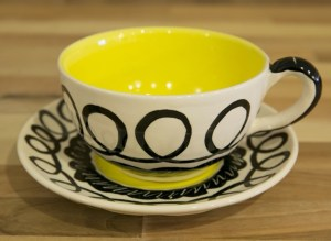Black and white cup and saucer in scribble