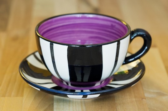 Black and white cup and saucer in broad stripe