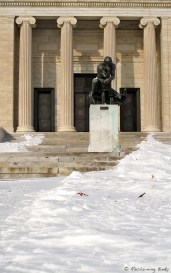 The Thinker flanked by waves of snow