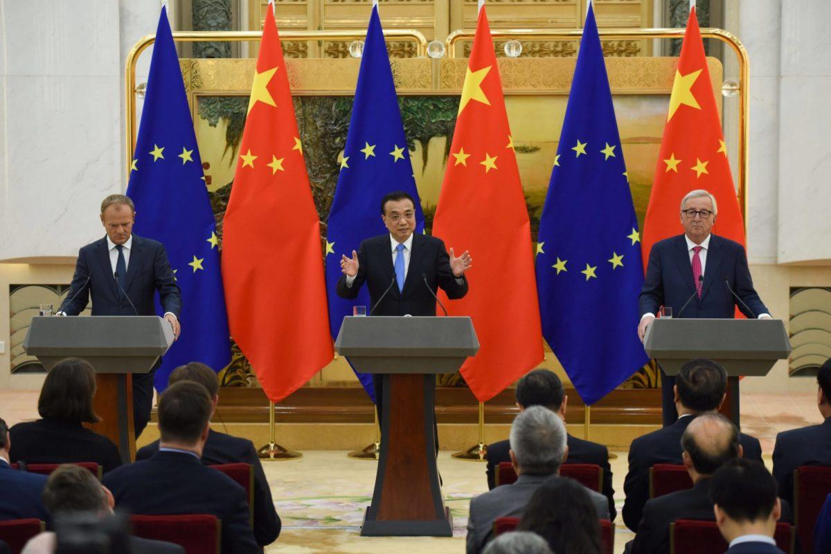Chinese and European senior officials speak at a public event; European companies