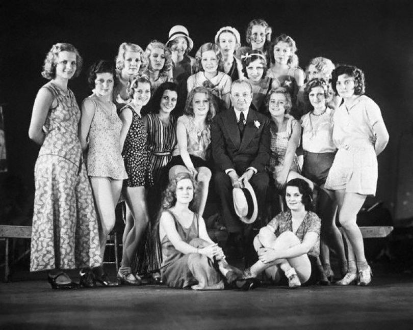 "May 20, 1931, New York, New York - Flo Ziegfeld, Dean of Broadway Revue Producers, known for ""glorifying the American girl"" is shown as he appeared at the Ziegfeld Theater with some of the beautiful American girls who are to be ""glorified"" in his new follies of 1931. This will be the first follies produced by the veteran showman in several seasons."