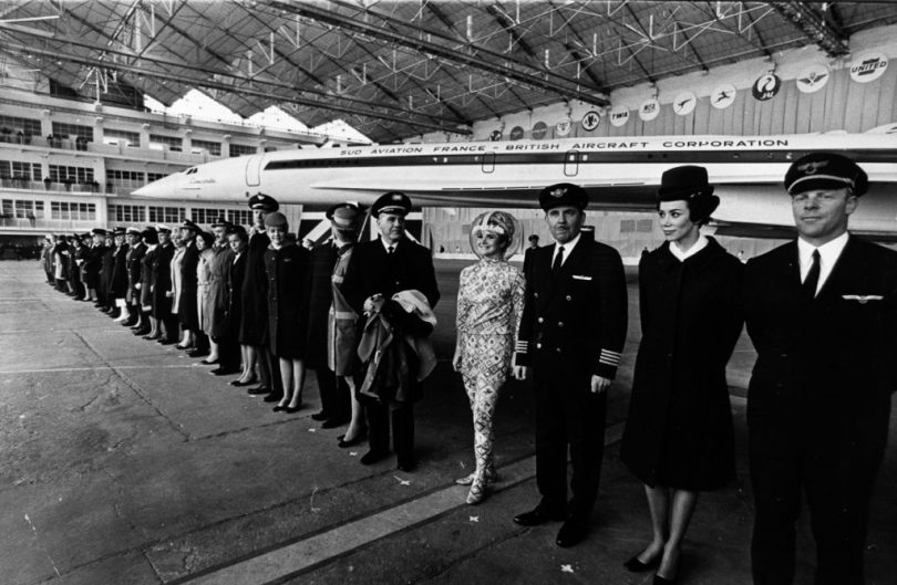 11th December 1967: Pilots and hostesses from airliners which have ordered Concorde, the world's first supersonic airliner, stand in front of the plane at the official roll-out ceremony in Toulouse. The space-age hostess is from America's Braniff International. (Photo by Keystone/Getty Images)
