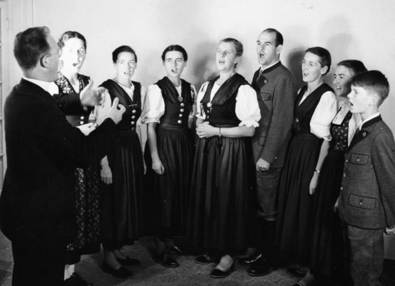 Portrait of the Von Trapp family singing; (L-R) Eleonore, Agatha, Maria, the Baroness, Werner, Hedwig, Martina and Johannes, they are conducted by Father Franz Wasner, London, circa 1950. (Photo by George Konig/Keystone Features/Getty Images)