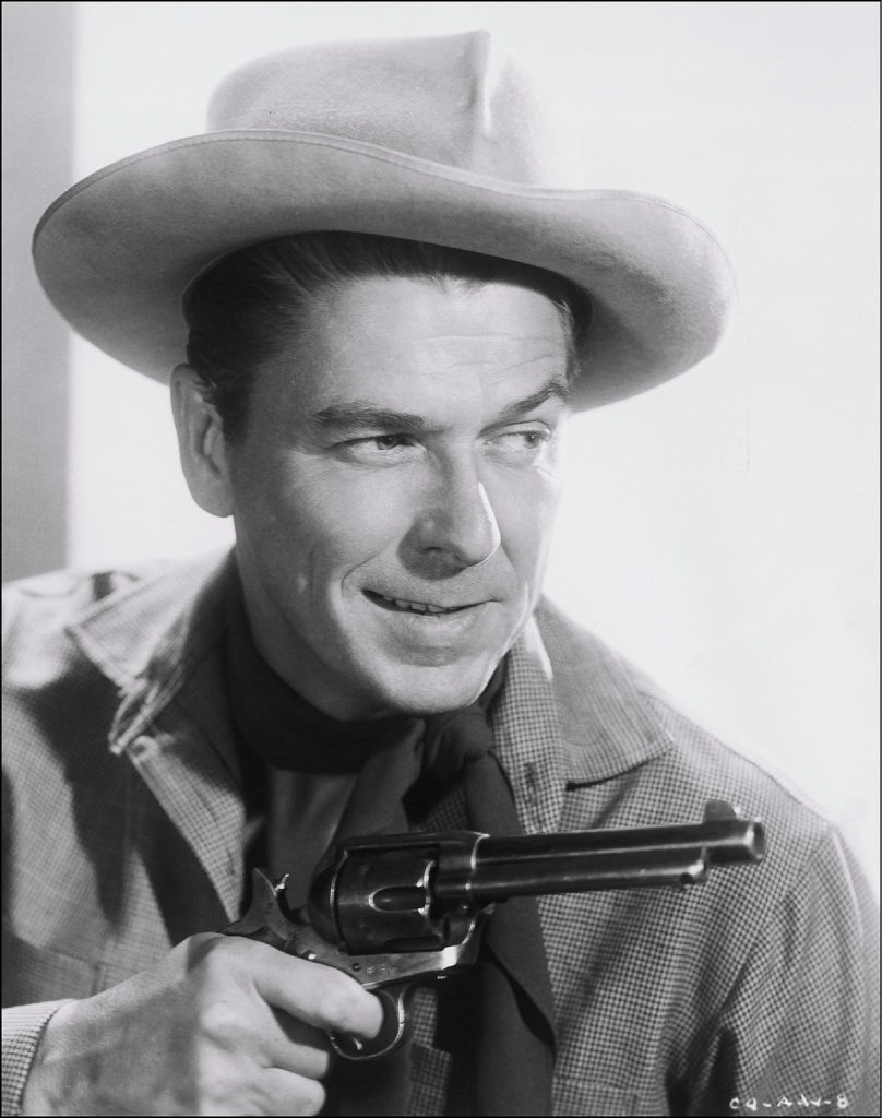 "1954. Ronald Reagan in ""Cattle queen of Montana"" film."