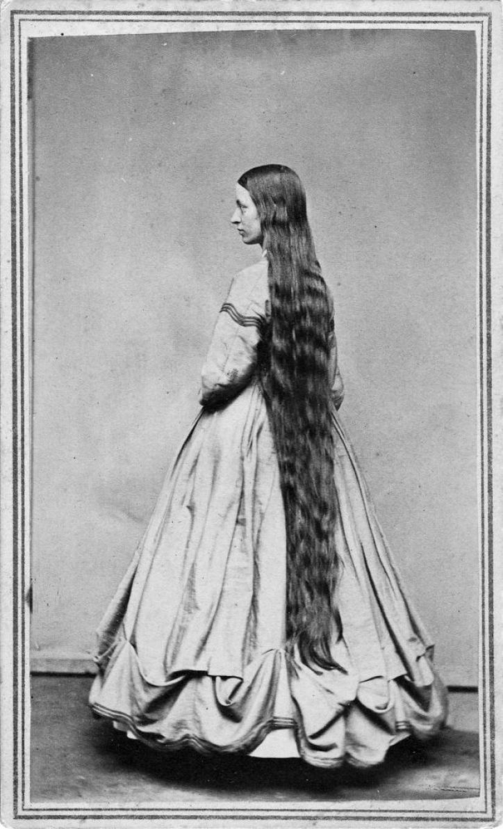 UNITED STATES - CIRCA 1865:  A woman poses to show her long hair in a studio around 1865 in an unknown location.  (Photo Reproduction by Transcendental Graphics/Getty Images) *** Local Caption ***