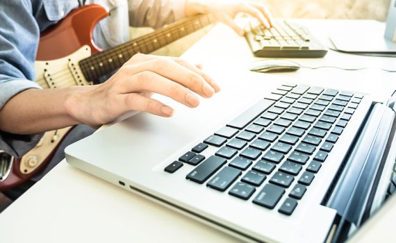 guitar-player-at-computer