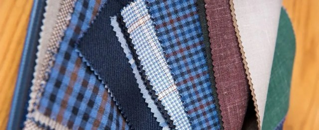 fabrics-samples-on-table-in-tailor-workshop