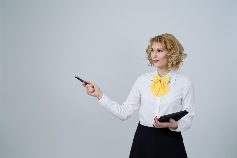 Tips for managers - smart-dressed businesswoman giving a presentation