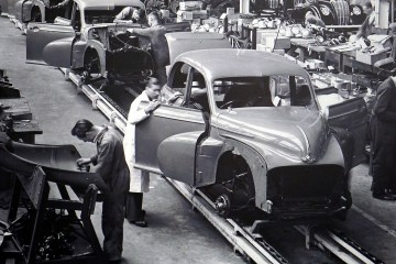 How to be productive - factory line with workers producing cars