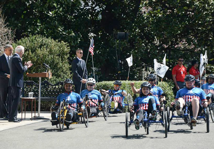 US soldiers on recumbent trikes riding at the White House