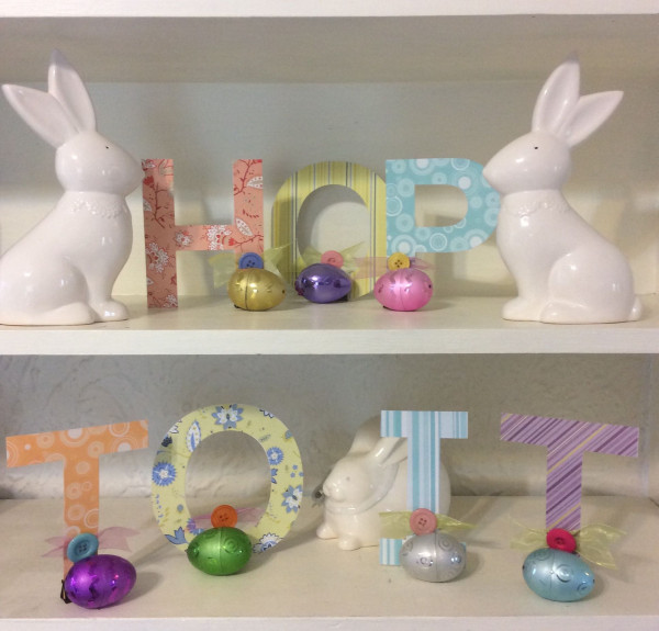 HOP TO IT Easter sign made with die cut letters and an office supply