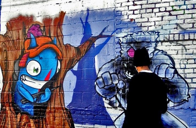 See-One-street-art-action-at-Bushwick-Five-Points