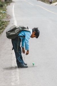 kid in street in ecuador