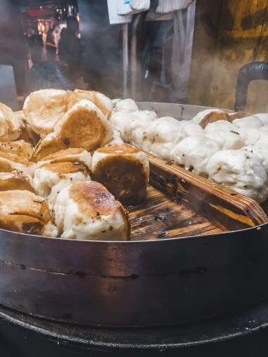 fried pork buns at night market in taiwan