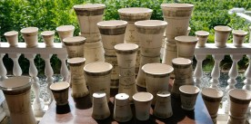 guy wolf more white pots on porch