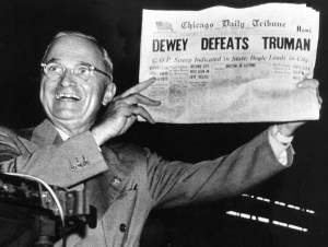 Victorious presidential candidate Pres. Harry Truman jubilantly displaying erroneous CHICAGO DAILY TRIBUNE w. headline DEWEY DEFEATS TRUMAN which overconfident Republican editors had rushed to print on election night, standing on his campaign train platform. (Photo by W. Eugene Smith//Time Life Pictures/Getty Images)