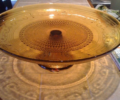 An amber Depression Glass cake plate.  With what GF treasure will you fill it?