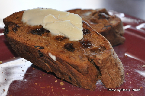Sliced gluten free pecan bread with Earth Balance spread.