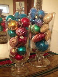 Shiny Brites and other vintage and reproduction ornaments are lovely in glass containers.