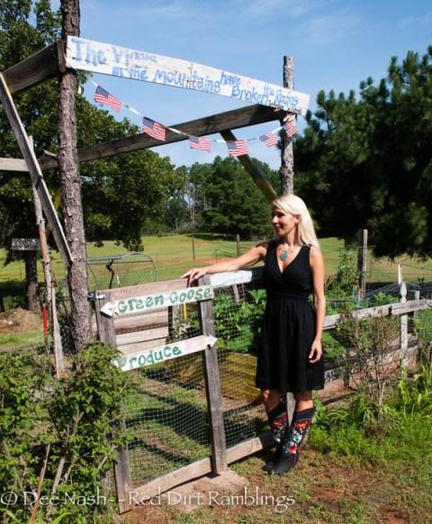 Marie next to her garden.