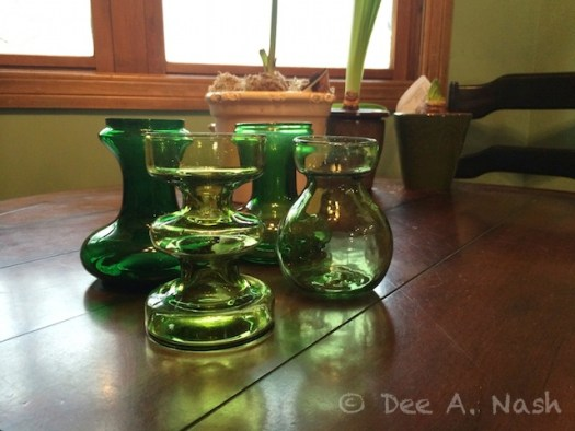 Four Green hyacinth vases