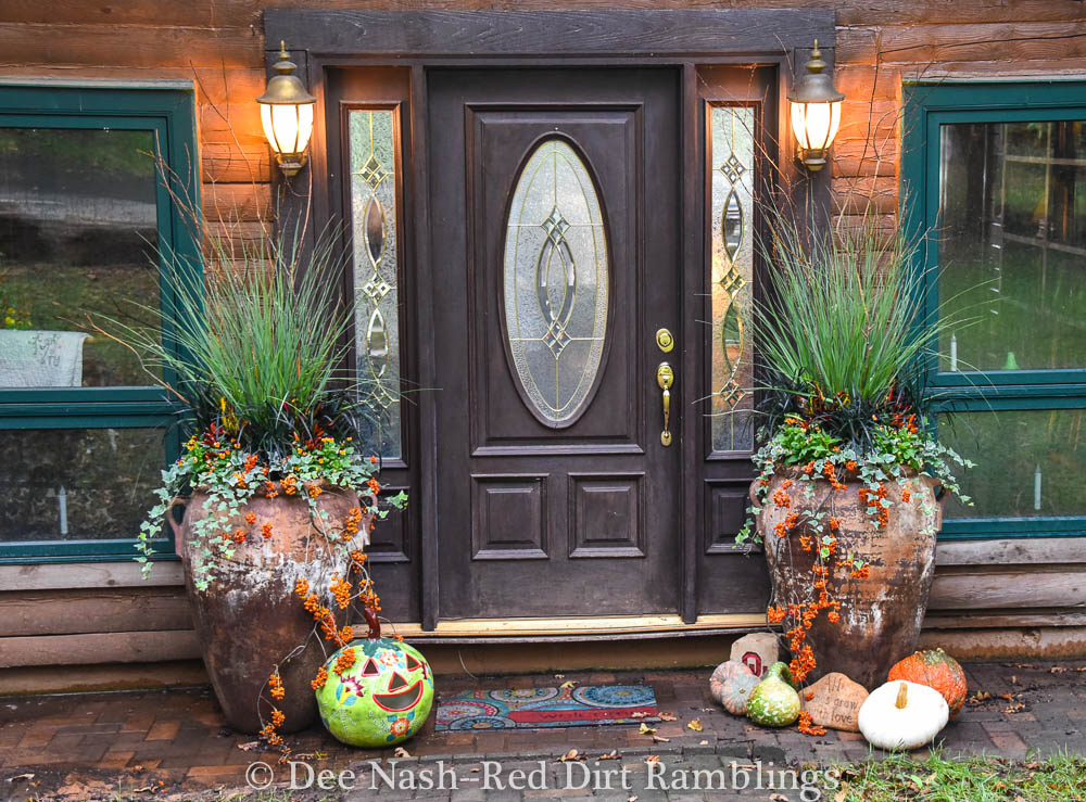 Front entryway with pots designed by Helen Weis at Unique by Design Landscape and Containers.