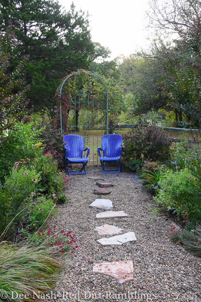 Purple chairs in the back garden look blue in this photo.