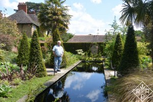 Bill standing beside the reflecting pool in what I think is the tropical garden.