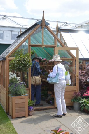 There were greenhouses everywhere. Remember when I had my greenhouse shipped? In England, you could just buy one on every corner at the show.