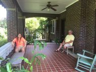 Bill and Claire relaxing on Eudora Welty's side porch. Claire was trying to pet Sal, the official cat of the residence.