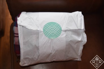 "Stitch Fix September Review. Your clothes arrive in a tissue-wrapped package that people call a ""burrito."""