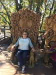 Sitting in one of the big carved chairs in the children's garden.