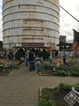 People lined up to visit Santa next to the silos.