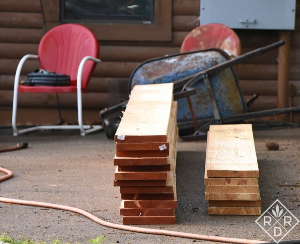 Boards for the raised beds all ready to be placed in the corners.