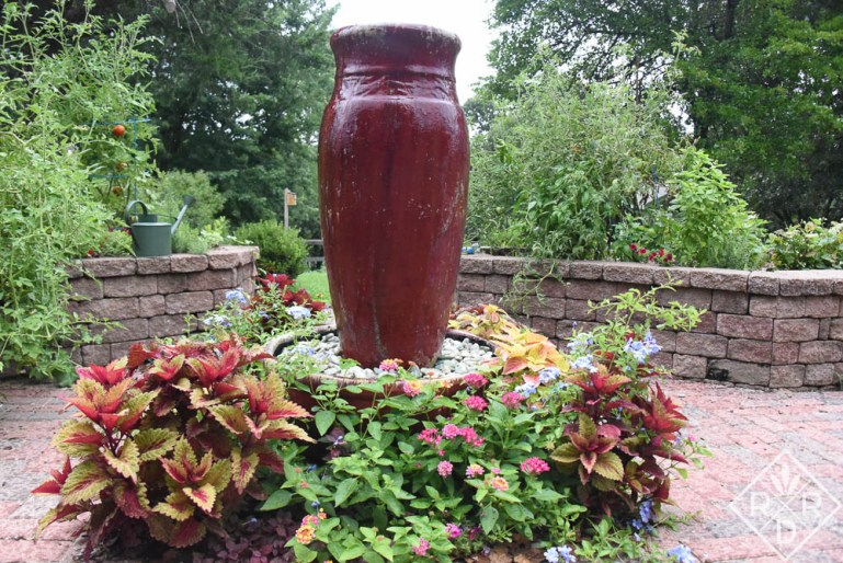 Red fountain in potager surrounded by 'Indian Summer' coleus, pentas, lantana, 'Alabama Sunset' coleus and tropical or cape plumbago.