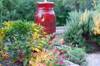 The red fountain that the birds love so much in winter. We keep a heater in it so they have fresh water. There is also a fountain on the deck.